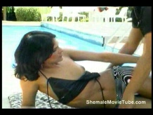 Shemale fucks a guy poolside